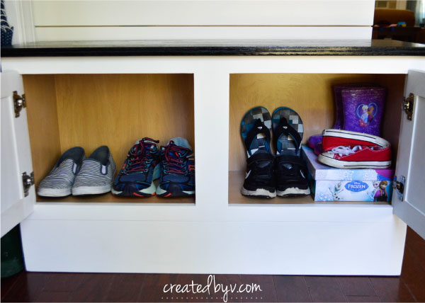 Inspired by Lowe's web series, The Weekender, we built a mudroom bench from a stock cabinet and a faux shiplap wall to upgrade the style, comfort and function of our entryway.