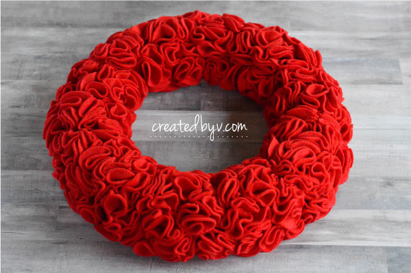Learn how to make this stunner of a wreath. Red + Ruffles. Merry and bright, indeed!