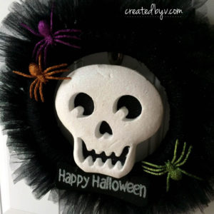 Welcome trick-or-treaters with this simple, affordable and adorable door decor.
