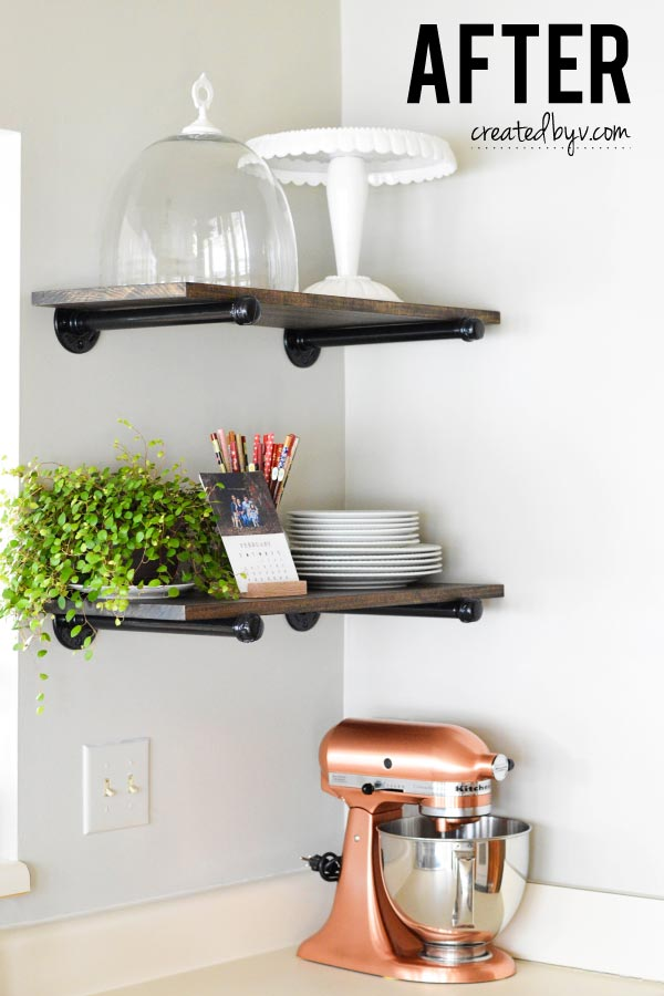 I'm in love! Metal pipes and fittings are such a clever repurpose. Wood planks bring a rustic charm and the open shelving is beautiful and functional.