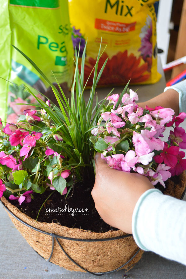 Hanging plant baskets are perfect for porches and patios! Quick and easy way to boost curb appeal and bring color and life to your outdoor space!